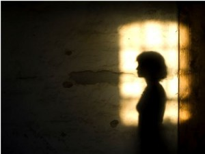 Woman's shadow on a wall