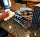 "Aaron Hanania autographing copies of his new book :The Kings Pawn"" for fans this week."