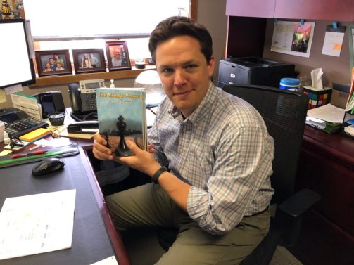 Bryan Hunt with his autographed books