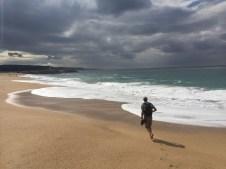 nazare-az-runs-on-beach