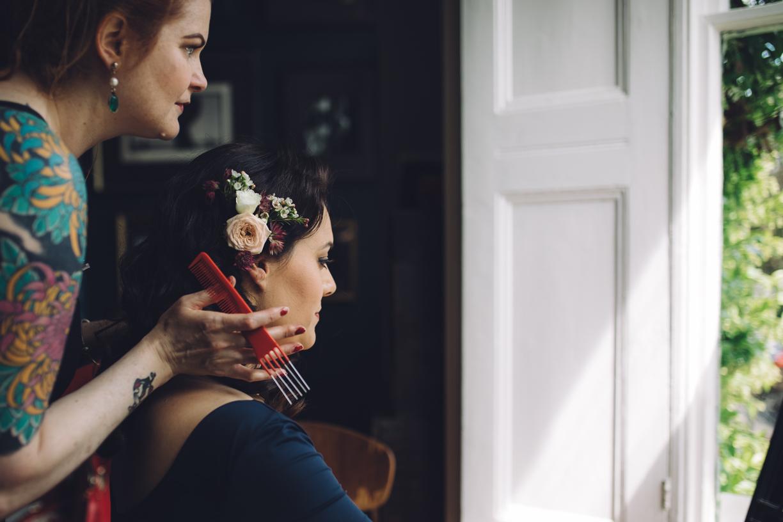 Bride getting hair prepared