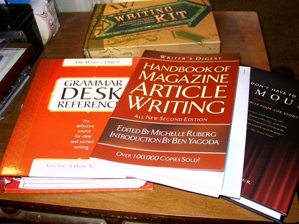 Color photograph of writing kit, comprising 3 texts on writing and grammar.