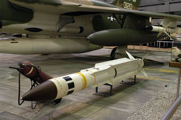 Color photograph of anti-radiation missile in the foreground and fighter jet in the background. Prequel to Eleventh Hour Covenant.