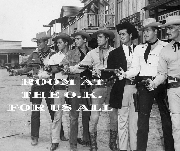 "Black and white photograph of 7 men in American Western cowboy clothes. Each one is pointing a gun. The words ""Room at the O.K. Corral for us all."" is superimposed on the image. Creative and Original."