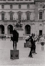 """People """"touching"""" the Louvre for photos"""