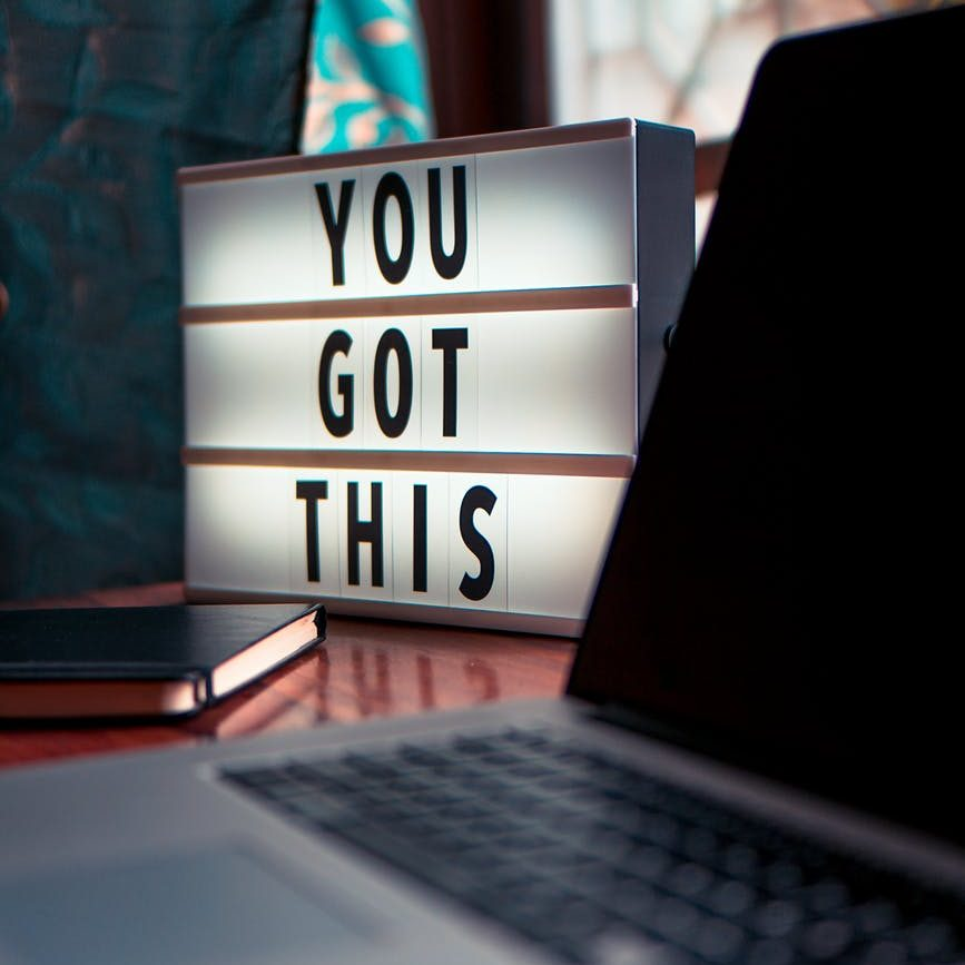 "a sign next to a computer that says ""you got this"""