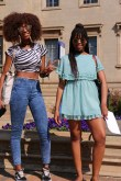 Rachel Tshiunza (left) and Neo Mosiane (right) are fashion forward this season in a striped crop top and breezy summer dress. Photo: Aarti Bhana