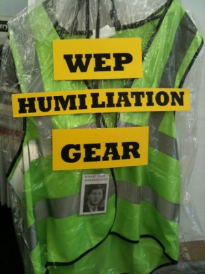 "The ""uniform"" of some WEP workers, with added commentary and a badge featuring HRA Commissioner Robert Doar. At a recent action, CVH members presented Commissioner Doar with this vest and badge, which he refused to accept."