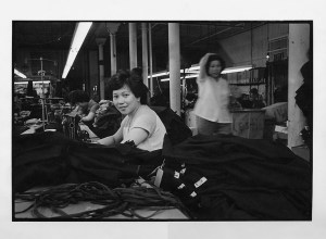 A woman in a garment factory on Canal Street. 1979-1982. Courtesy of Paul Calhoun, Museum of Chinese in America (MOCA) Collection.
