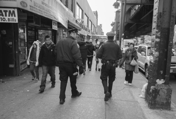 NYPD officers on patrol on Roosevelt Avenue. Photo by Thomas L. Mariadason.
