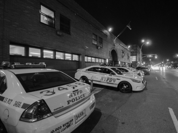 Patrol cars dispatched from the 115th Precinct are a regular presence along Junction Boulevard and Roosevelt Avenue. Photo by Thomas L. Mariadason.