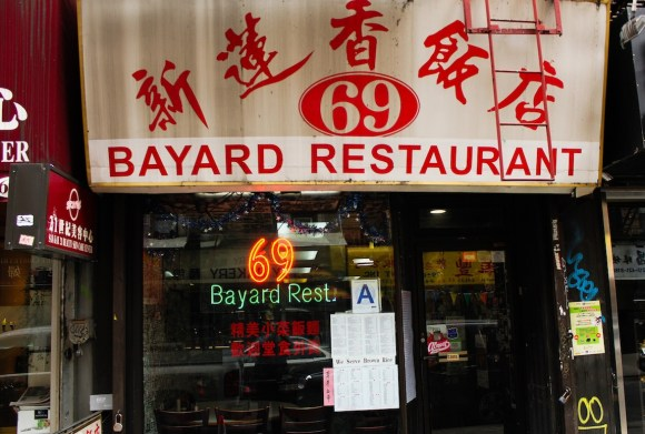 The restaurant at 69 Bayard in Chinatown displays an A letter grade in its window. Photo by Brian Nunes.