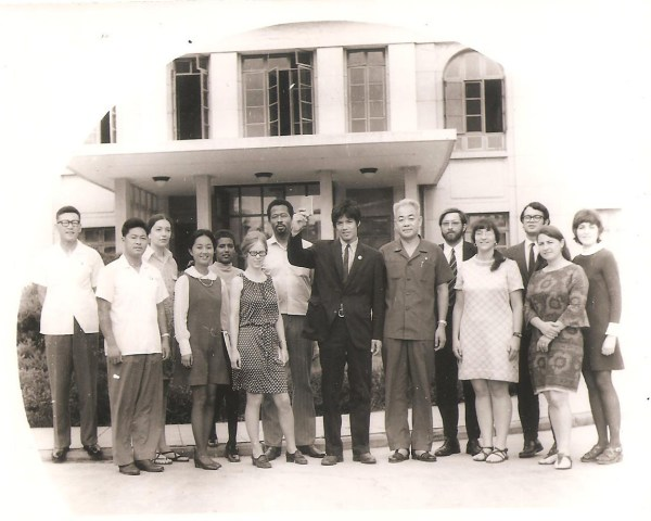 Alex Hing (center) in front of the Chinese Embassy in Pyongyang, North Korea, in YEAR. (Photo: Courtesy Alex Hing)
