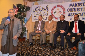 Khan has made connections outside Little Pakistan. He speaks at Brooklyn Pakistan Day program in March 2014 with Borough President Eric Adams and others. (Photo courtesy Shahid Khan)