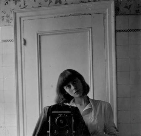 Diane Arbus. Self-portrait. 1945. Gelatin silver print. 10.8 x 11.2 cm. Copyright The Estate of Diane Arbus.