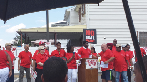 Members of Stop the Prison in South Ozone Park organization at a neighborhood rally in August. Photo by Nadia Misir