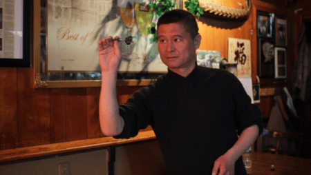 Jason Xie was the first Chinese to join the dart competitions in the Tavern.
