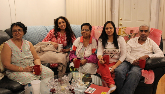 The Lal family spends a Sunday evening together gyaffing, watching the Miss USA pageant and drinking tea. From left to right: Caneza Ramon, Ashley Lal, Tatpati Lal, Rebena Lal and Mark Lal. Photo by Nadia Misir