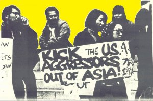 """From the cover of """"STAND UP: An Archive Collection of the Bay Area Asian American Movement 1968-1974,"""" Asian American Political Alliance (AAPA) protest outside of UC Berkeley's Greek Theater at a 1968 anti-war rally. Photo credit to Asian American Movement 1968."""