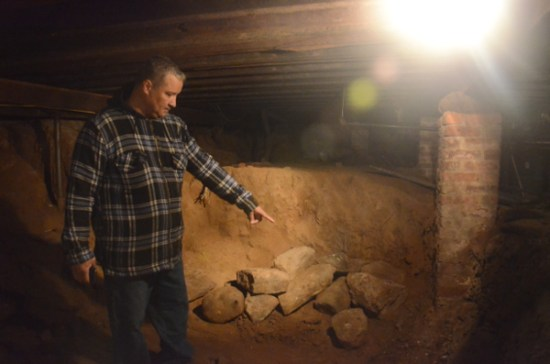 Pastor Mike Ortiz points to the spotin the basement of the church where the remains where found.