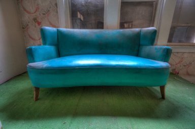 Mid-century sofa, seen in an abandoned resort Photo by Andy Milford