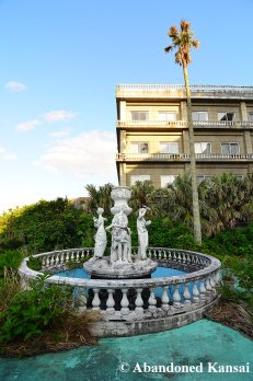 Damaged Statues In Front Of A Hotel
