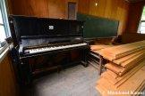 Abandoned Black Piano