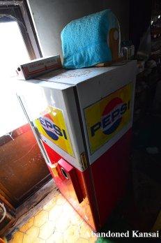 Coke Machine With Pepsi Sticker