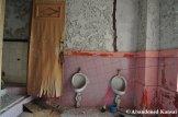 Pink Bathroom With Urinals