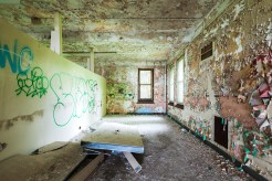Some of the large, open day rooms were likely converted to dormitories during the asylum's years of overcrowding. Many of the shoddily constructed partitions are toppling today.