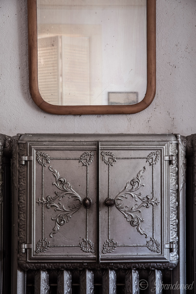 Abandoned Furnishings and Radiator in Dining Room