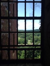 Looking through broken window to area around building 93