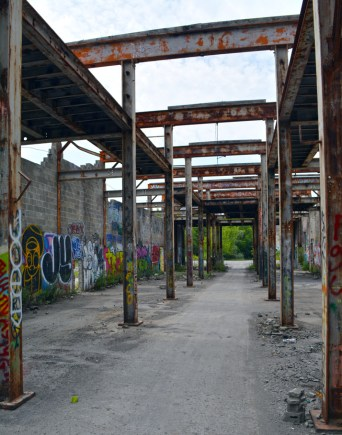 Roofless cinder block building with graffiti on walls