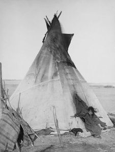 Author: John C.H. Grabill, digital restoration by Michel Vuijlsteke via Wikipedia Commons Oglala girl in front of a tipi