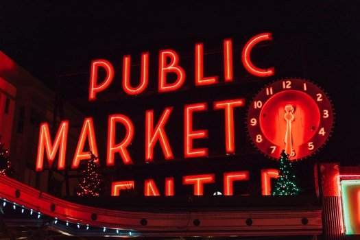 Pike Place Market Christmas Lights at night red clock and red sign