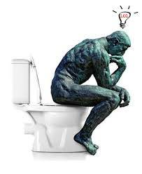 statue of man thinking on loo