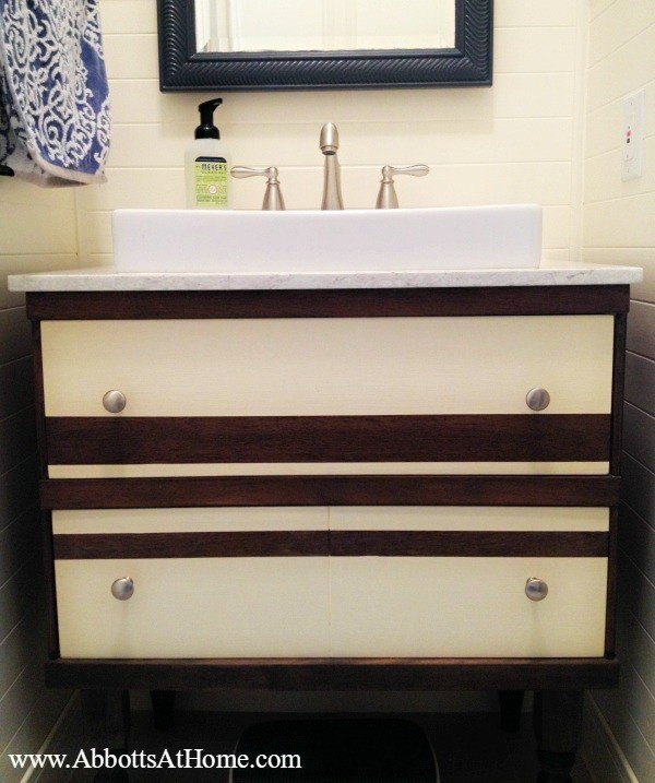 DIY Furniture Remodel: How I cut 1 dresser in half to make cute toy storage and a bathroom vanity.