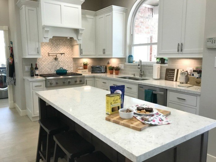 White Kitchen Remodel with Silestone Lusso Quartz and Starmark Cabinets. How we changed the layout to make more room, added better organization, our finishes. Plus, our 3 regrets.
