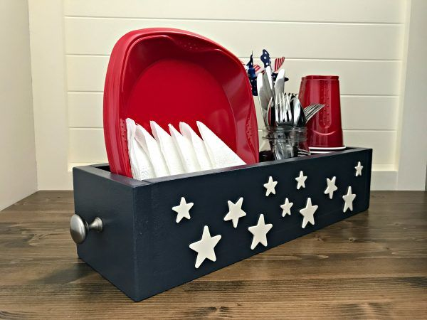 Make an Easy Patriotic Table DIY Utensil Caddy, just $7. Give those summer backyard BBQ's and beach picnics a patriotic touch with this American themed utensil caddy basket. Makes great home decor, gifts, craft party projects, centerpieces, and more. Can be sold at craft fairs and online too.