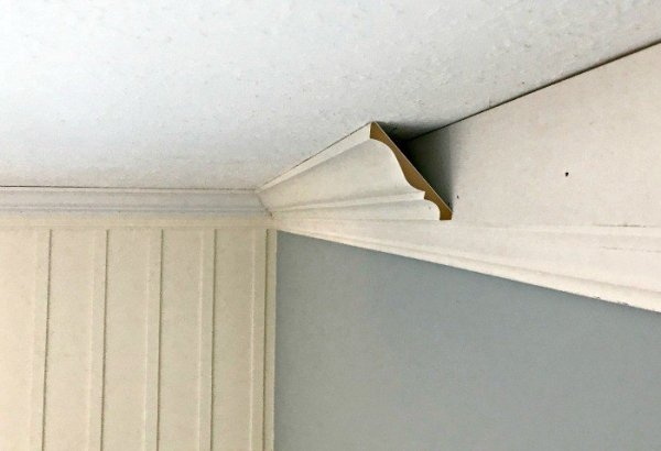 Crown Molding Installation above board and batten. DIY Board and Batten Wainscoting with lattice. Wainscoting ideas with classic style and Farmhouse woodworking charm.
