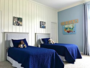 It's time for the boys bedroom makeover reveal, guys! And I'm so excited to share it with you. The whole room is full of awesome DIY projects, affordable decor, and fun boys bedroom ideas. I'm loving it and so are my boy's! This is a blue, white, and grey bedroom full of pops of fun colors. I think it's a bit Farmhouse, a bit traditional, and a bit Land of Nod. I designed this for my boys, but most of the ideas would work for all kids, boys and girls. #kidsbedroom #kidsroom #boysbedroom #bedroomideas