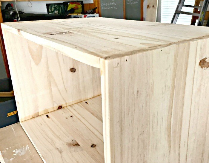 The sides of the box have been glued and nailed together. Build a Modern Farmhouse DIY Wooden Toy Storage Crate or Box for all of those kids toys cluttering up your house. Makes a beautiful throw pillow and blanket box in a Living Room or catch all storage box for teens too! #AbbottsAtHome #StorageBox #ToyBox #DIYStorage