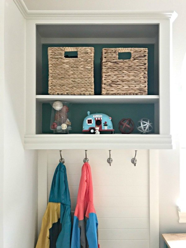 DIY Hall Tree from converted wall cabinet. A fresh Modern Farmhouse look using teal, wood, and lots of white. This Modern Farmhouse Small Laundry Room Design is full of easy DIY projects and affordable decor. #LaundryRoom #ModernFarmhouse #Teal #AbbottsAtHome