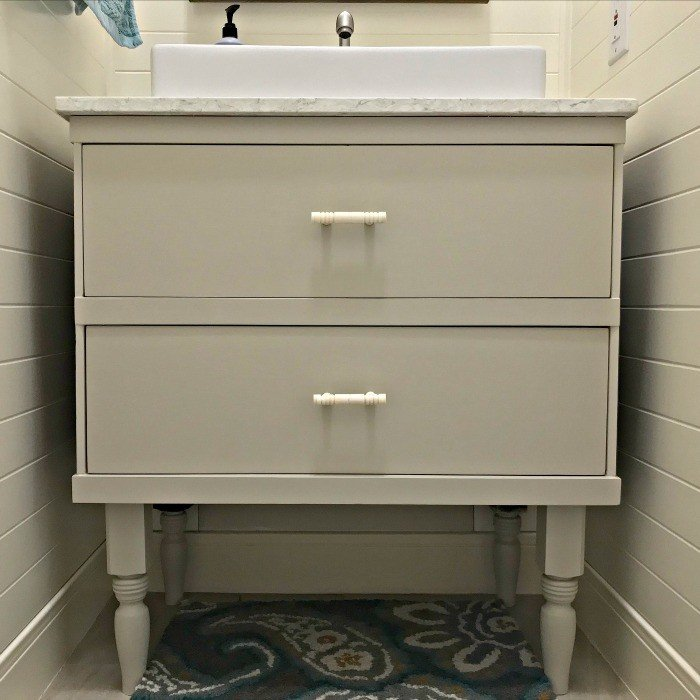 If you're wondering how to convert that dresser into a vanity, I've got some tips for converting a dresser into a vanity. And how-to steps to cut and modify the vanity drawers for plumbing. #AbbottsAtHome #DIYVanity #BathroomVanity #BathroomIdeas