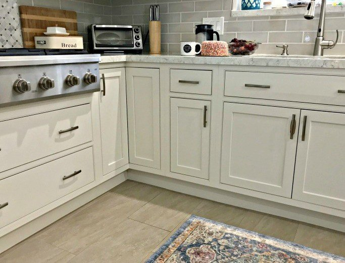 Caulking That Small Gap Between The Cabinets And The Floor Is An Easy Way  To Make