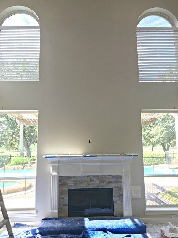 A beautiful Shiplap Fireplace Wall in a Living Room with vaulted ceilings. Here's how it was made and why it was a near fail, guys. It's all about material choices. But, I ended up loving it after a couple simple fixes. #Shiplap #Fireplace #LivingRoom #FixerUpper #AbbottsAtHome