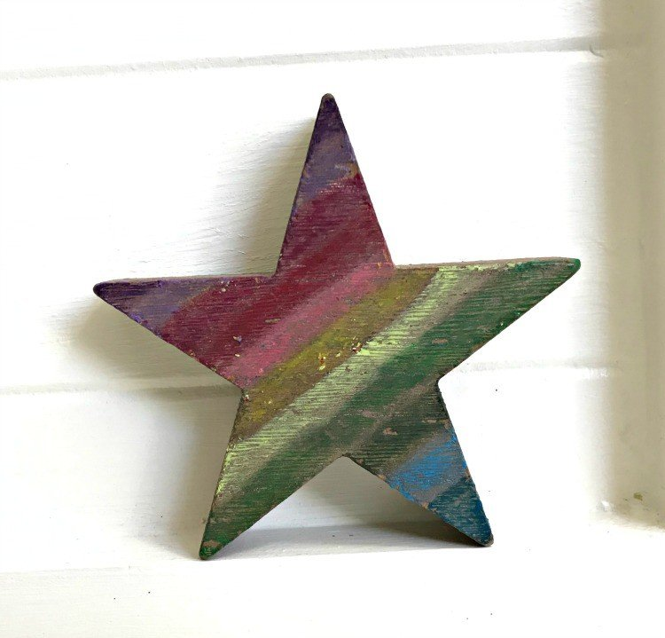 Crayon Ornament. Need some new ideas for this years Christmas craft? I've got 12 fun and easy handmade Christmas Ornament Ideas for you! Make 3D scrapbook paper trees, pom pom trees, star string art, unicorn stars, and more. #AbbottsAtHome #Handmade #ChristmasCrafts #ChristmasIdeas #ChristmasOrnaments