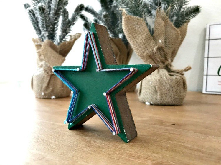 Star String Art. Need some new ideas for this years Christmas craft? I've got 12 fun and easy handmade Christmas Ornament Ideas for you! Make 3D scrapbook paper trees, pom pom trees, star string art, unicorn stars, and more. #AbbottsAtHome #Handmade #ChristmasCrafts #ChristmasIdeas #ChristmasOrnaments