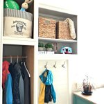 Love this DIY! Here are the cheap and doable DIY projects I used when I Added a Mudroom to our Laundry Room. #LaundryRoom #Mudroom #HomeRemodel #MudroomBench #AbbottsAtHome