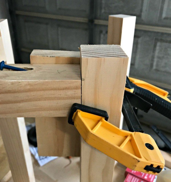 Using clamps and scrap wood to hold 22x2 Pine pieces in the right spot when gluing and screwing together.